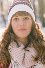 Portrait of a beautiful young girl with winter hat