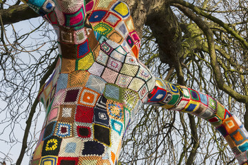 Trunk and branches of a Yarn bombed tree. 1,500 crocheted  squares