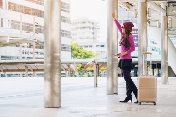 Woman traveller in airport walkway. Travel concept.