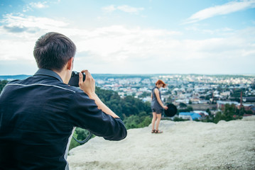 man taking picture of ginger girl
