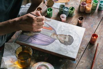 Artist painting icon