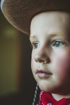 Young boy dressed up like a cowboy with hat and bandana