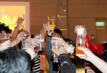 glasses with alcohol and toasting, party