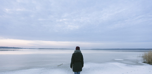 Back view of woman on frozen lake