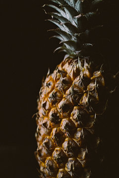 One pineapple on simple black background