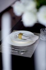 white plate and fork table