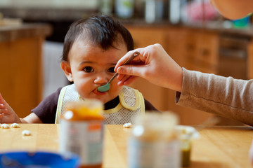 Baby: Mother Feeds Baby Variety Of Foods