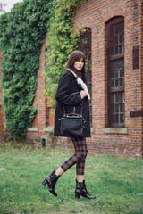 Girl walking in plaid pants