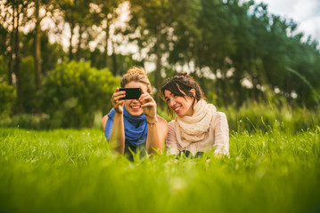 two girls taking photo