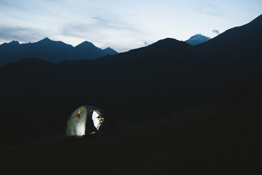 Man camping in the mountain at night