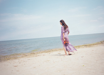 Woman Having a Walk on the Beach