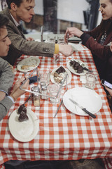 Group of Young Friends Sharing Desserts in a Pizza Joint