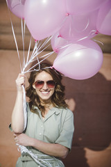The girl with pink balloons