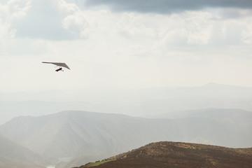 man practicing hang-glider