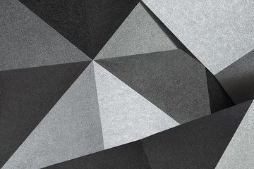 Geometric shapes of silvery paper, background