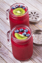 Berry kiwi smoothie in the jars