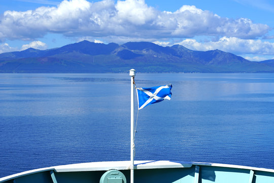 A blue and white Scottish flag on a ferry headed to Arran, Scotland