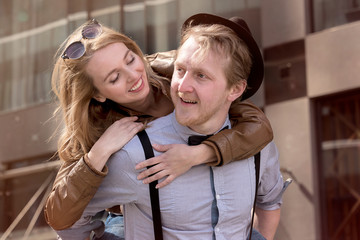 Guy with the blonde girl, fun, play, laugh
