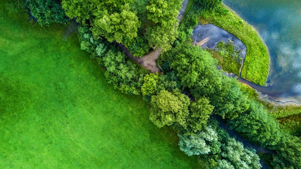 Drone flight in the summer above the are of Aachen with its flields, forest and meadows