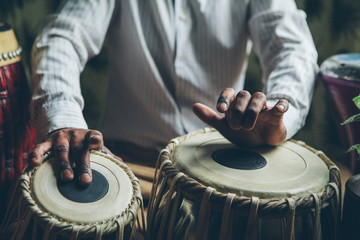 Indian man playing traditional indian drums