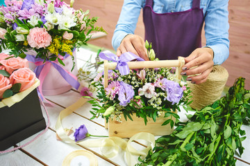 The florist makes the bouquet top view on background white Board