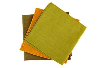 Three colorful textile napkins on white