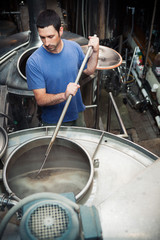 Beer: Brewer Busy Stirring Contents Of Mash Tun