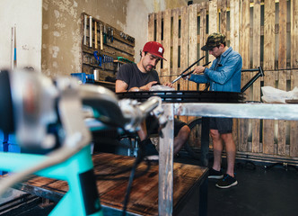 Two Employees at Work in Hip Bicycle Shop