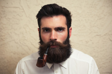 A man with a beard and a pipe