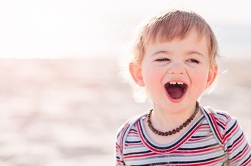 Happy smile of a toddler at the beach