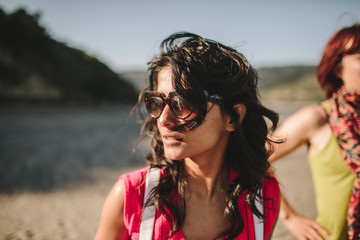 young woman enjoys the sun at the beach