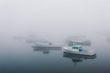 lobster fishing boats shrouded in mist