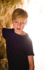 Boy in a backlit tunnel