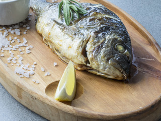 Dorado fried with flavouring herbs