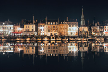 Honfleur harbor by night in Normandy, France