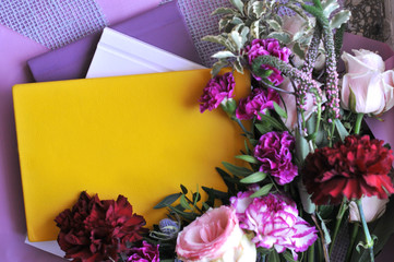 Yellow book of entries for the hidden thoughts of a young girl on a beautiful floral background.