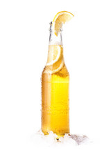 Papiers peints Biere, Cidre Front view of a bottle of blonde beer with lemon inside and white background