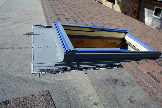 Installing Skylights in new house. Bitumen roof shingles. Vapor barrier and Waterproofing. Unfinished roof.