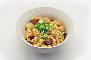 Fried rice with garlic and deep fried pork in bowl Japanese style on white background