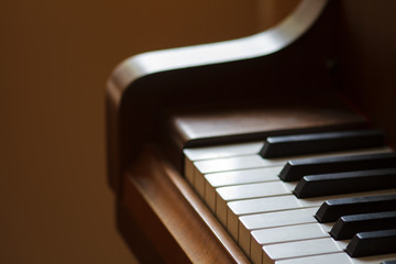 Piano keys close-up with a beautiful blurry background.