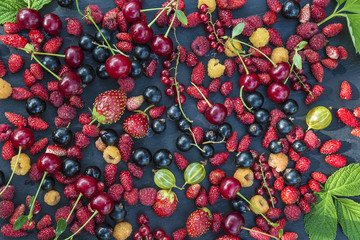 health food concept/different fresh berries on slate background