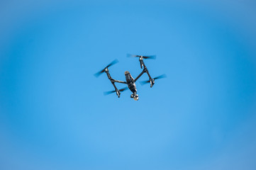 Drone in sky/Dron-quadrocopter soars in sky
