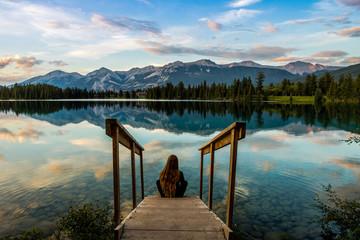 girl sitting on stairs enjoying the sunset, jasper national park  Fototapete