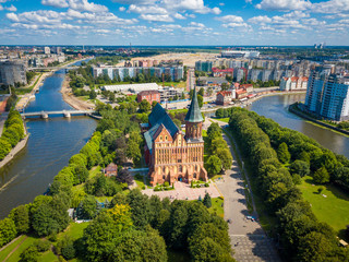 Aerial cityscape of Kant Island in Kaliningrad, Russia at sunny summer day with white clouds in the blue sky