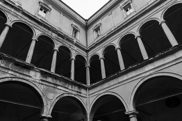 Arches of a renaissance courtyard at one of the old building of the Bologna university