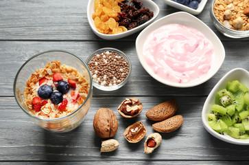 Tasty breakfast with yogurt on table