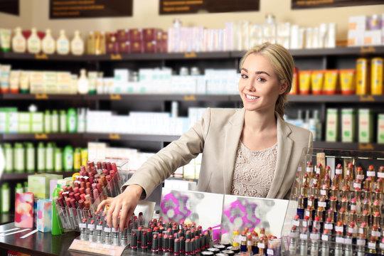 Beautiful young woman in beauty store