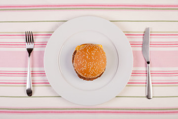 stock image of burger on white plate. diet conceptual
