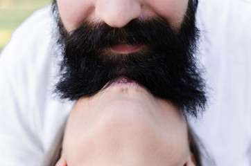 cropped portrait of funny couple with man big beard and mustache