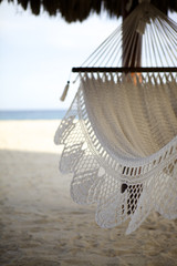 Detail of hammock in the shade at the beach